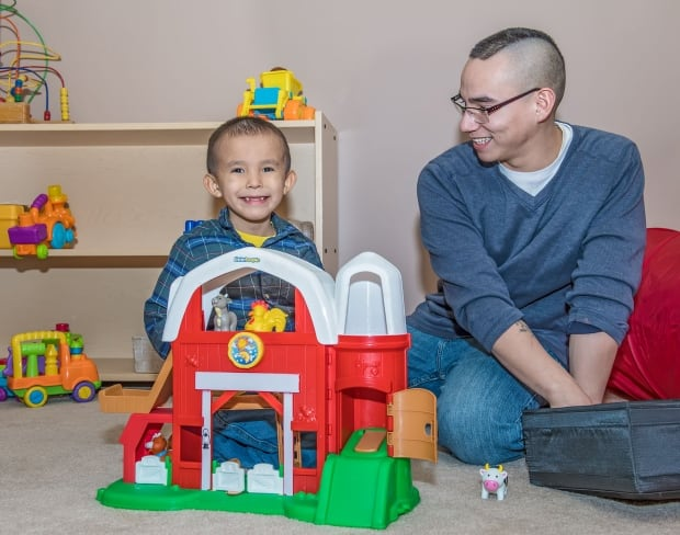 Michael Moze, 24, and son Treyson, 5 years old